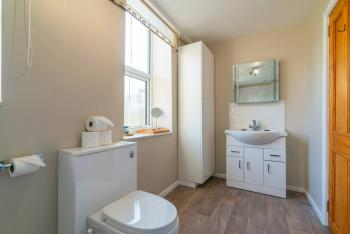 The bathroom with vanity unit and spa bath