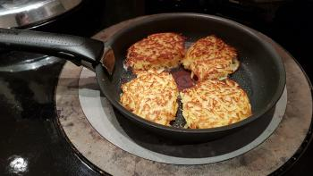 Homemade Hash browns sizzling on the Aga