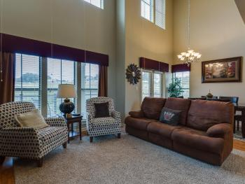 Spacious living/dining area with private balcony.  Queen sleeper sofa for additional sleeping arrangements.