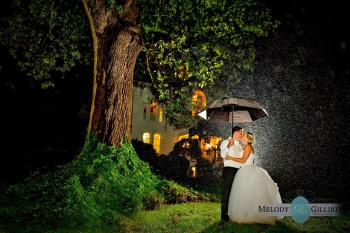 The Rain didn't matter at all for this Bride and Groom as they kissed again under the 250 year old White Ash Tree in the front yard.