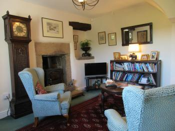 Guests' snug with TV, guide books and maps