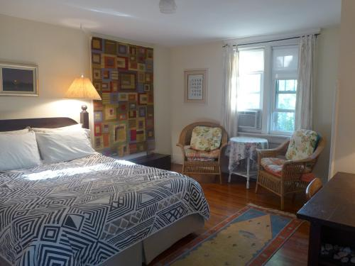 South room with queen bed and shared bathroom