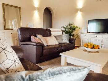 Relax and unwind in our guest lounge, with flat screen television, log fire and comfy sofas.