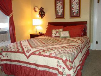 Queen size bed, sitting area with TV with DVD, VHS, and private bath.