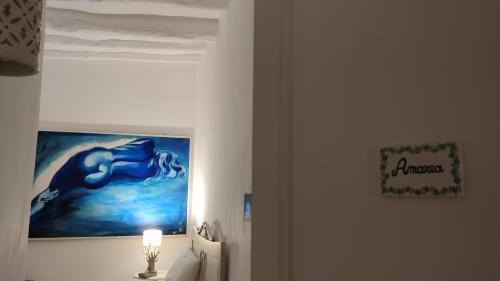 Camera Tripla-Superiore-Bagno in camera con doccia-Balcone-Amarea