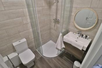 The bathroom boasts everything you need for your stay.