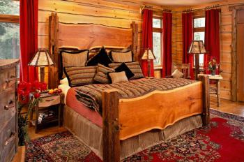 """Pine"" Guest room has a king-size bed, sitting area, fireplace, Jacuzzi, and  lake view porch"