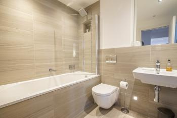 New fitted bathroom with access from the bedroom and living areas.