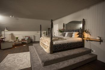 Loft  with fourposter king sized bed and sitting area