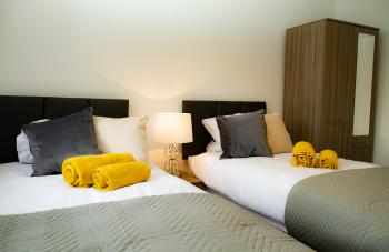 Kings House - First bedroom set as twin single beds. This room is usually set as a Super King size double.