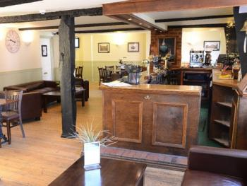 The Hollies Inn - Main Bar / Reception before if was moved to the left.