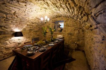 The dining room, with original stone barrel vaulted ceiling,  can be booked exclusively with private chef