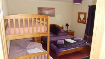 Quad room-Shared Bathroom-Garden View-Purple Room - Base Rate