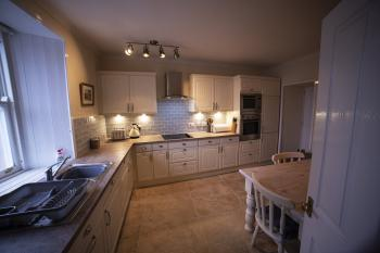 Dining kitchen with views to the sea and utility room off