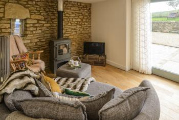 cosy sitting area with woodburner and Freeview TV