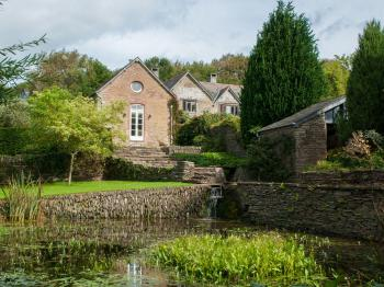 Ranscombe Holiday Cottage - View of the cottage from the pond
