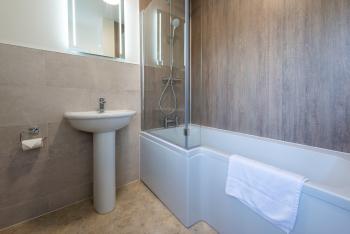 En suite bath and shower