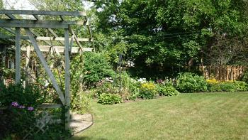 Our pergola helps to capture the serenity of the garden and provide a place of rest among the flowers