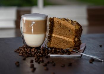 Latte with a coffee and walnut cake