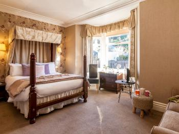 Relax in our bright four poster room