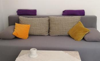 Sofa Nahaufnahme im Wohnbereich © Ferienwohnung Casa Belle Vacanze