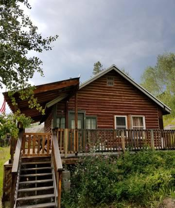 Log cabin in town with private, enjoyable wrap around deck and bbq