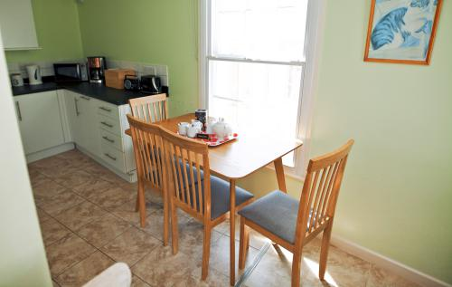 table + 4 chairs, highchair available