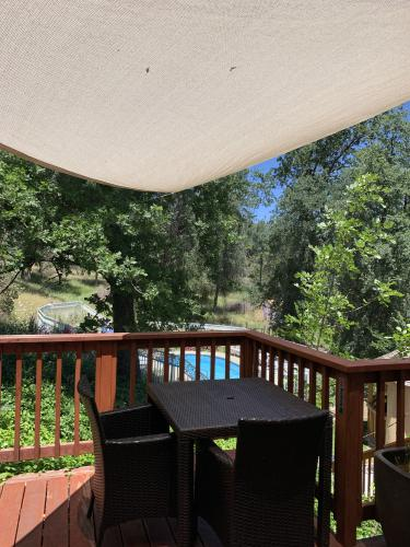 Attached Deck with view of the pool