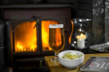 Relax by the fire with a drink