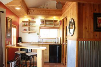 Bogie's Bungalow - Kitchenette (mini fridge, stove top and microwave) with bar seating