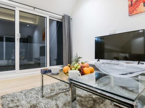 Large flat screen TV and coffee table also sliding doors which leads to balcony