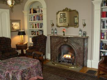 The Mayhurst Library, where wine, cheeses, snacks, and soft drinks are served daily  We invite you to select a book (including books about our Civil War), sit by the fire and enjoy the quiet.