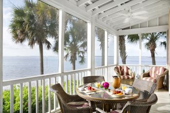 Each Cottage features a private screened in porch, complete with table and chairs, rockers and a hammock.
