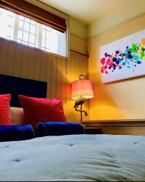 Room 3 features flamingos and bold coloured art work. Perfect for a disco nap or an evening of indulging.
