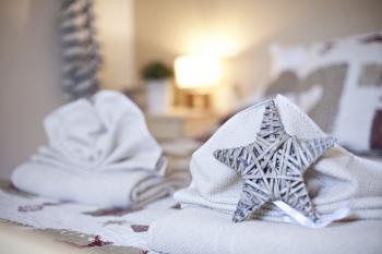 Lits faits à votre arrivée, kits serviettes en location
