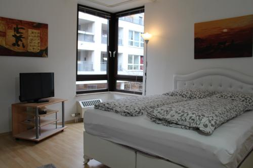 Suite-Deluxe-Ensuite Bad-2 Schlafzimmer - Booking.com Messe