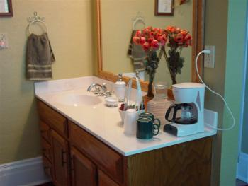 The Rhoades Suite has a private bathroom.