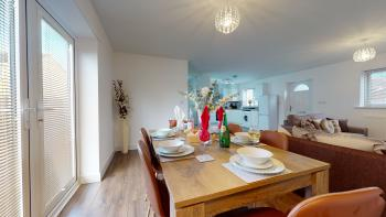 Spacious open plan lounge/diner, table and 6 chairs with patio door to garden