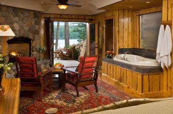 """Forest"" Guest room - walk out to your private lake view patio with your own fire pit"
