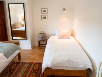 A single bed in bedroom 2