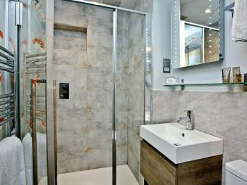 Second shower room with basin and toilet