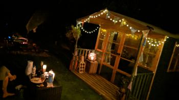 Summerhouses with solar fairy lights and candles