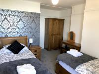 Deluxe Double Family Twin Bedroom with Ensuite shower & Sea Views
