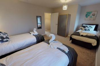 Bedroom 1 x3 Single beds or 1 Single & 1 zip & link to King size on request