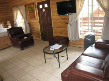 "ALL OUR CABINS PROVIDE A SITTING AREA ""LIVING ROOM"""