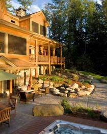 walk out to the patio with hot tub overlooking the gardens and lake