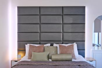 First Floor bedroom with striking and comfortable headboard with integrated reading light.  Bed has integrated tread lighting to safely guide you in night mode to kitchen or bathroom
