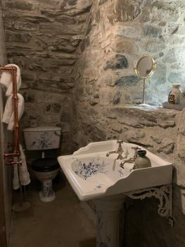 'The Snug' with painted vintage bathroom suite