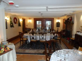 Mayhurst Dining Room set for Christmas Dinner for 24. Also shows doors to patio.