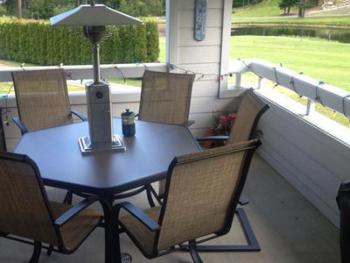 The private deck looks out over the golf course and has its own private BBQ as well as outdoor seating.